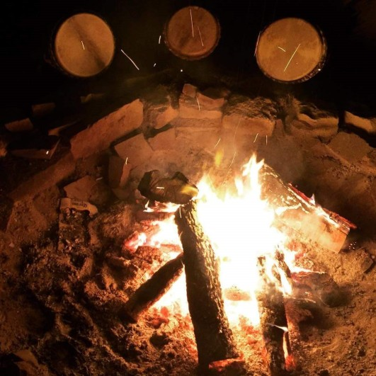 drums warming around fire